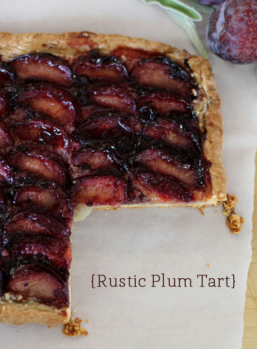 rustic plum tart on white parchment paper