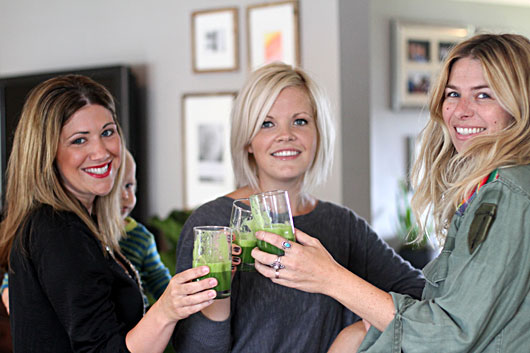 friends doing a green-juice-taste-test