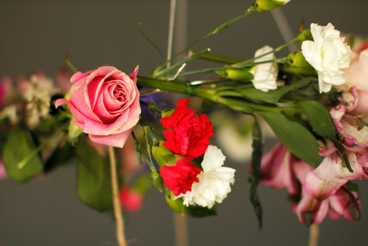 pink roses, carnations tied to a floral chandelier