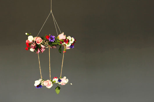 DIY Hanging floral chandelier with carnations and roses hanging from the ceiling