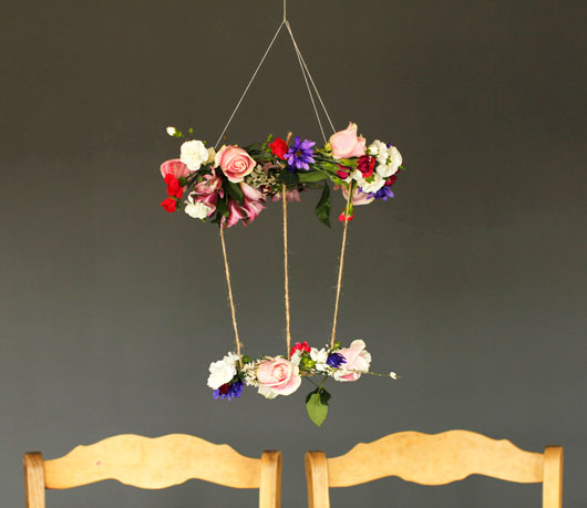 DIY Hanging Floral Chandelier against a gray wall