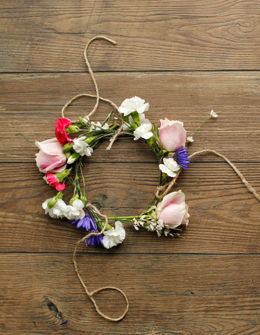 floral hoop with jute strings tied to it for a DIY hanging floral chandelier