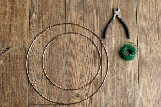 wire hoops, floral wire and wire cutters against a wood backdrop