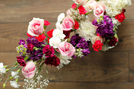 roses and carnations tied to a metal hoop