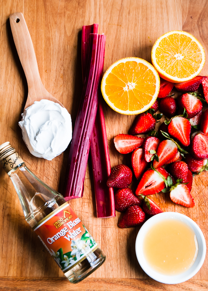 rhubarb, oranges, rose water and yogurt on a cutting board