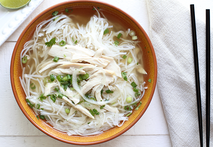 A bowl of Chicken Pho ga with chops sticks to the side