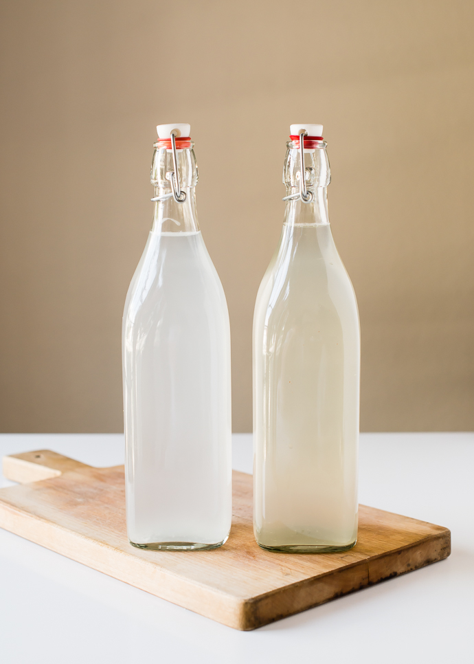 two glass bottles full of fermented water kefir