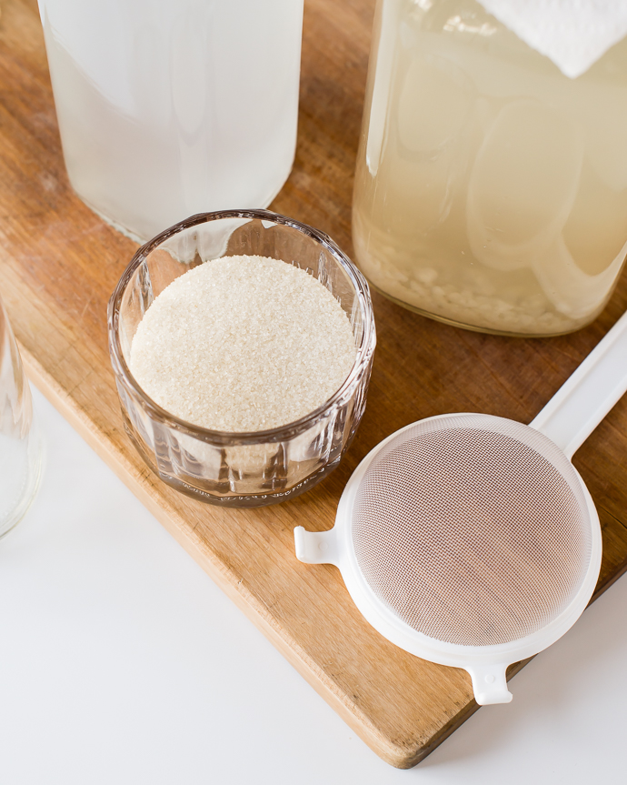 organic evaporated cane juice in a glass on a cutting board