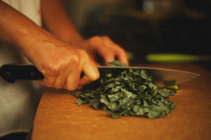 chopping kale for a fresh in-season salad