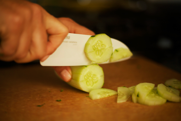slicing cucumbers for a salad