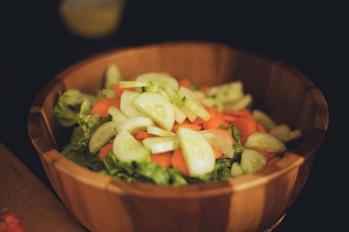 romaine, carrots, cucumbers in a wooden bowl