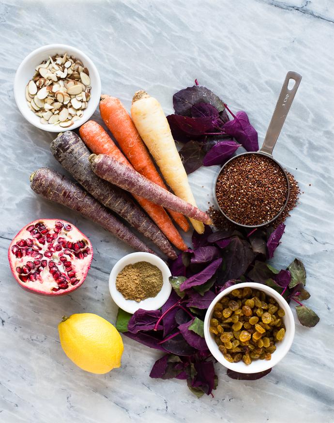 rainbow carrots, pomegranates, almonds, raisins, spices, lemons and quinoa