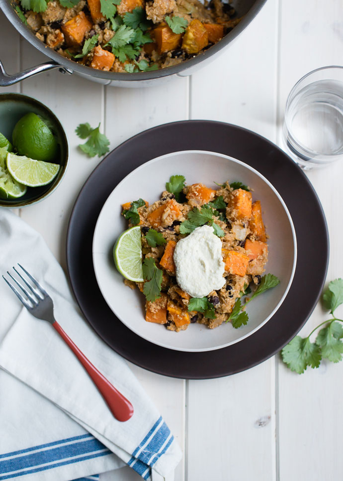 sweet potato bowl topped with cashew cream