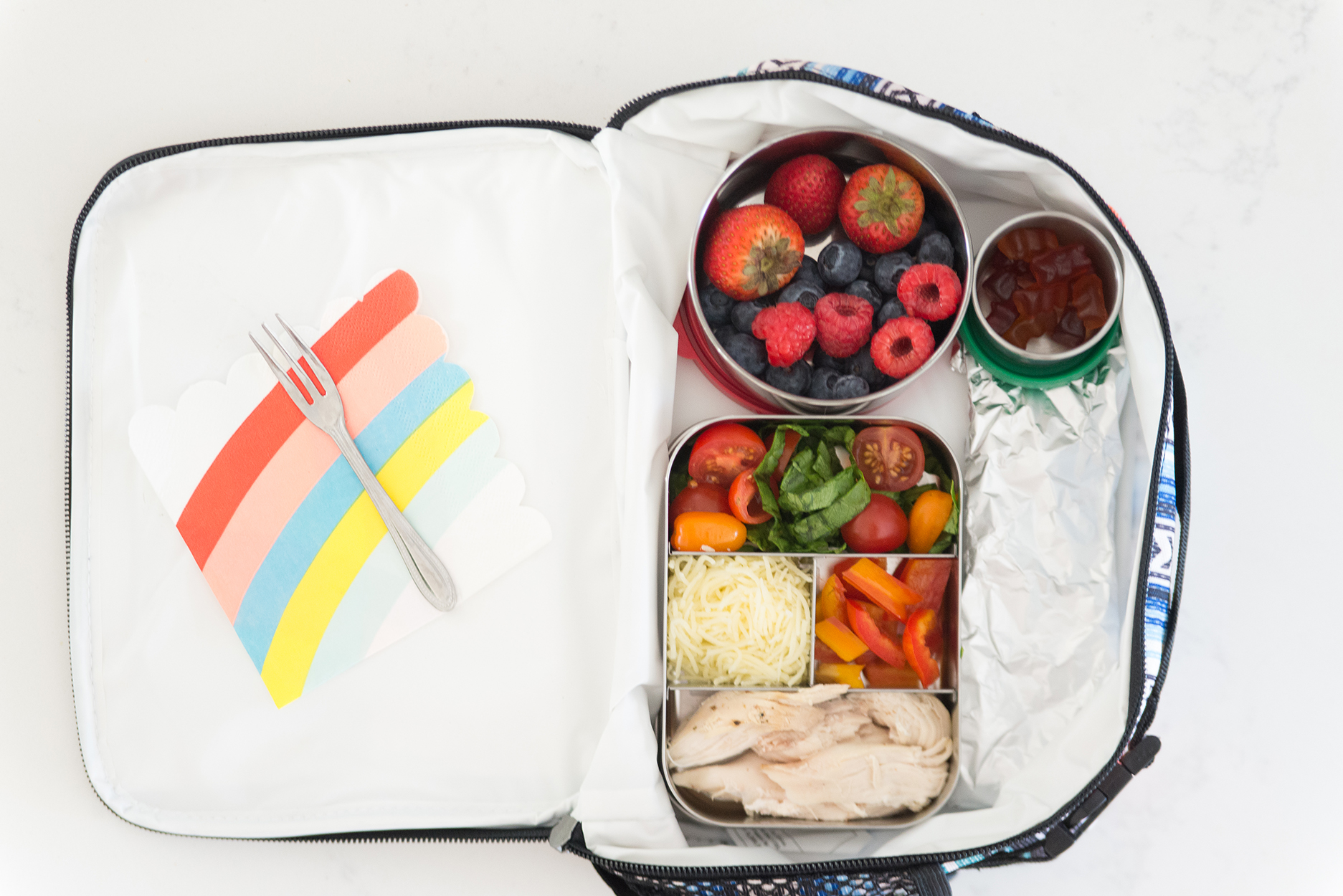 lunch box with a bento box inside full of fruit and veggies