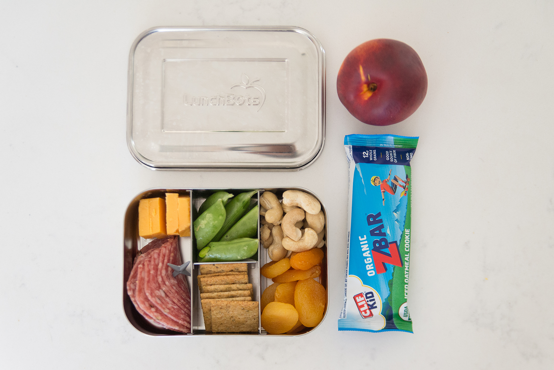 Stainless steel bento box kids lunch with a z par and peach