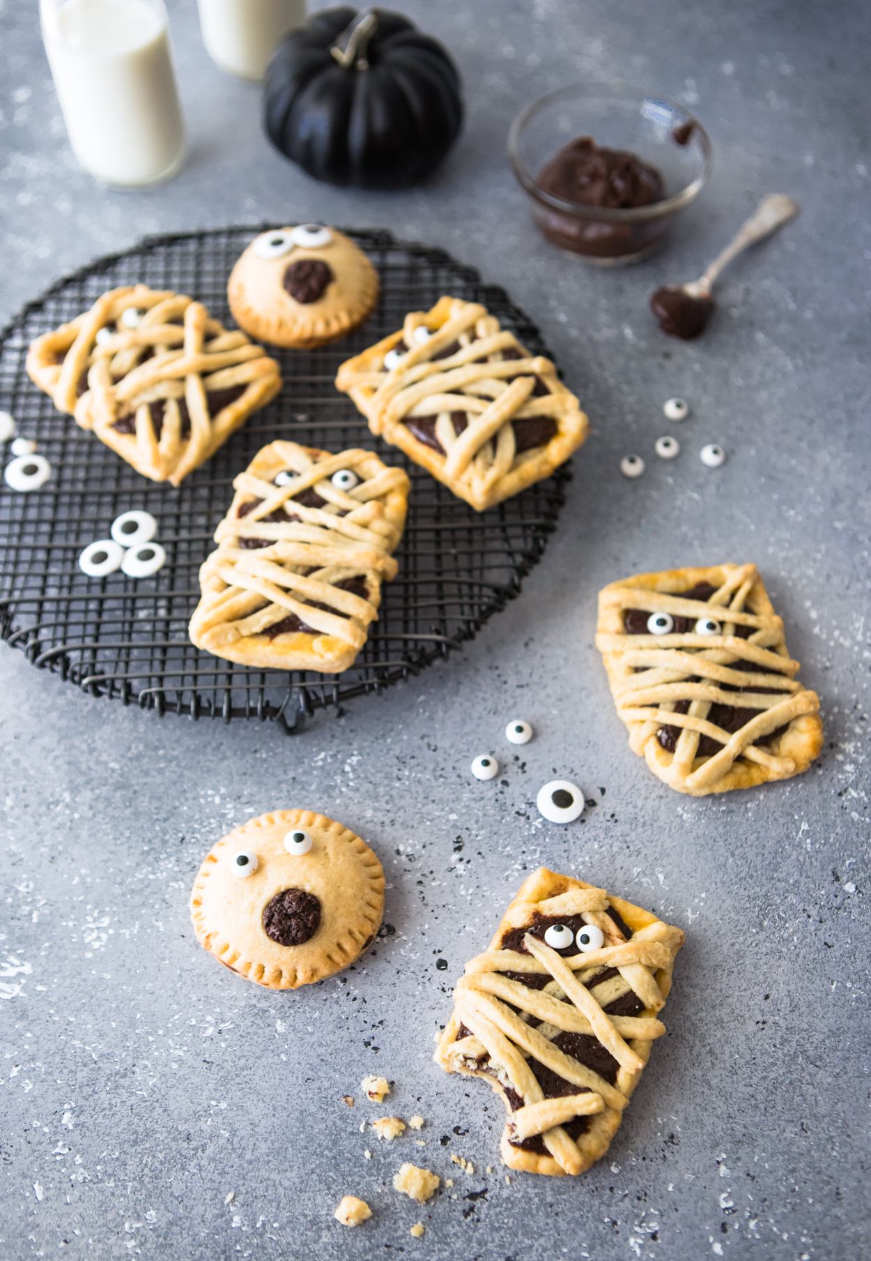 Chocolate filled hand pies on a black baking rack against a gray backdrop