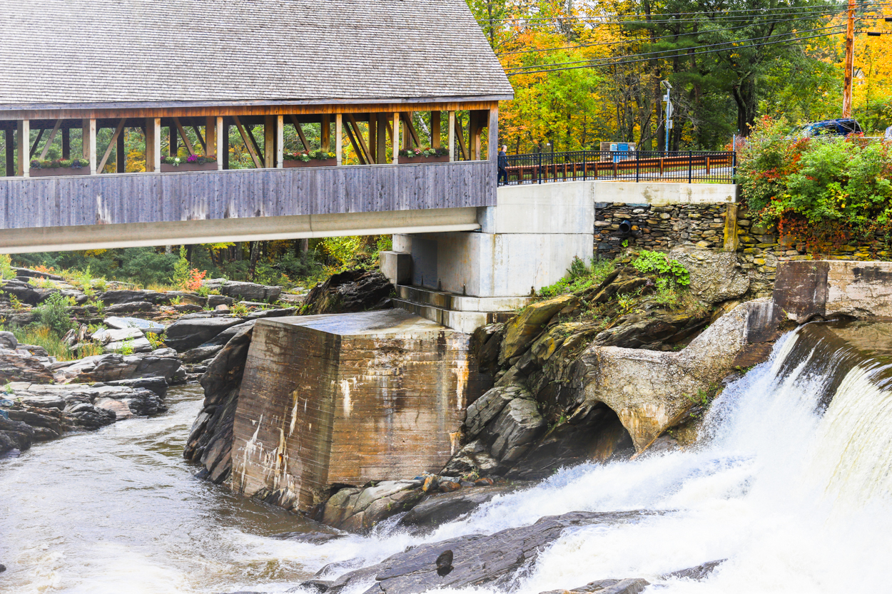 Covered bridge over the Ottauquechee River falls in Quechee Vermont