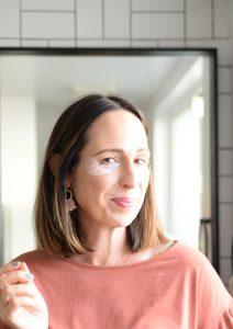 Beautycounter eye masks on brown hair woman