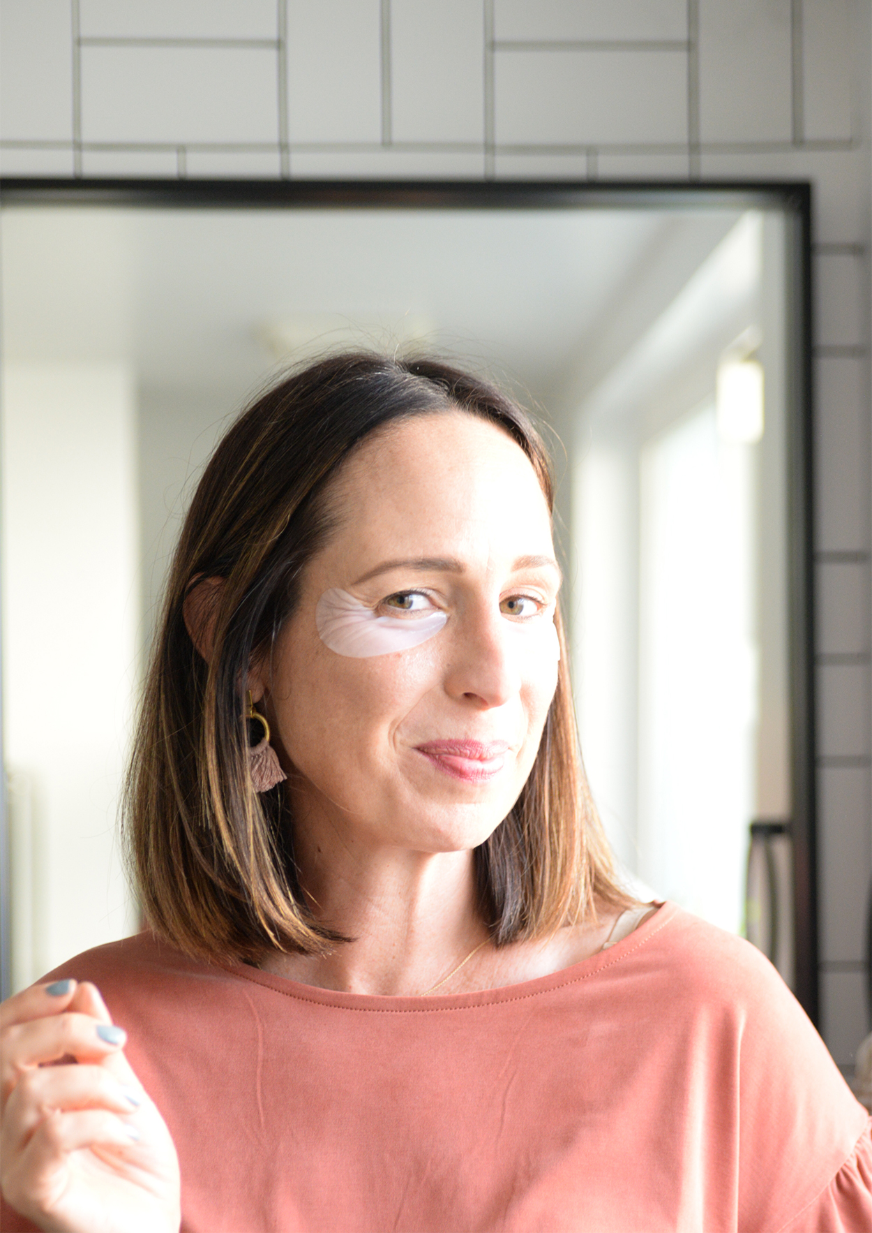 Beautycounter eye masks on brown hair woman