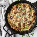 brown rice and turkey meatballs in a cast iron skillet