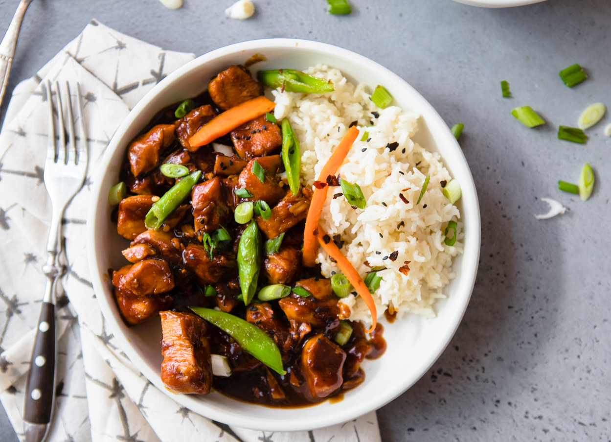 General Tso's Chicken with rice in a white bowl