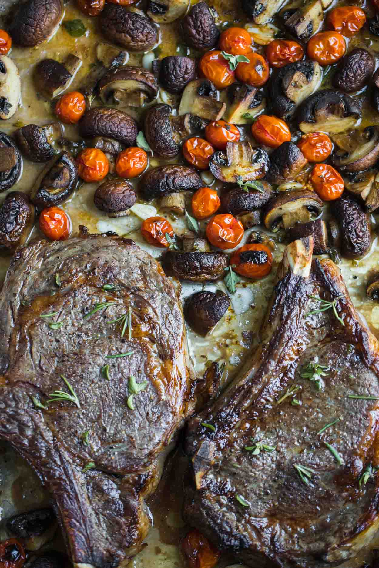 Steak, mushrooms and tomatoes on a sheet pan with fresh herbs and Marsala wine
