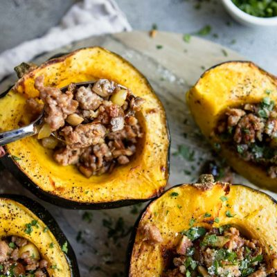 Roasted acorn squash with pork sausage and apple and chestnut stuffing