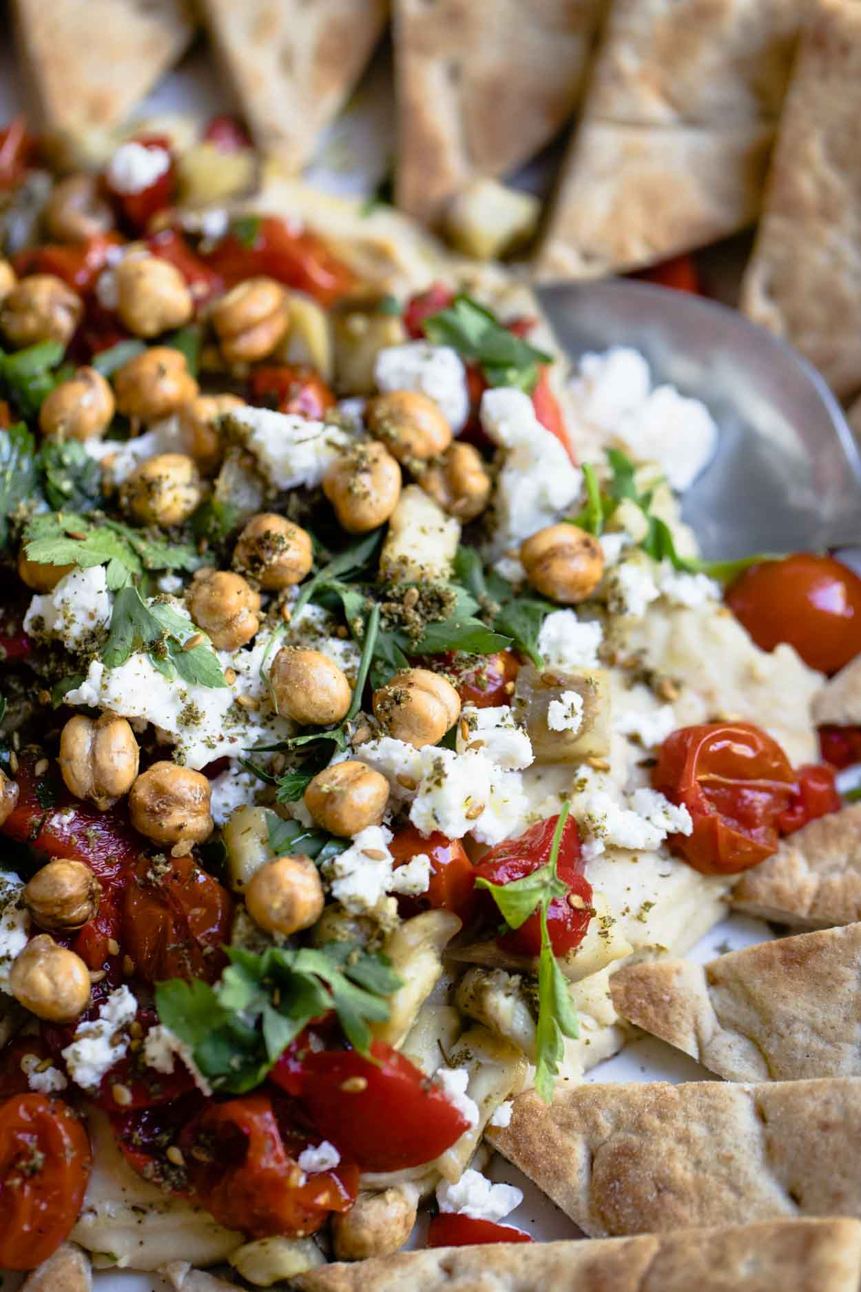 hummus with parsley, tomatoes, feta and eggplant