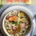 Pork posole soup in a beige bowl garnished with radishes, limes, and cabbage with pork posole script in red lettering