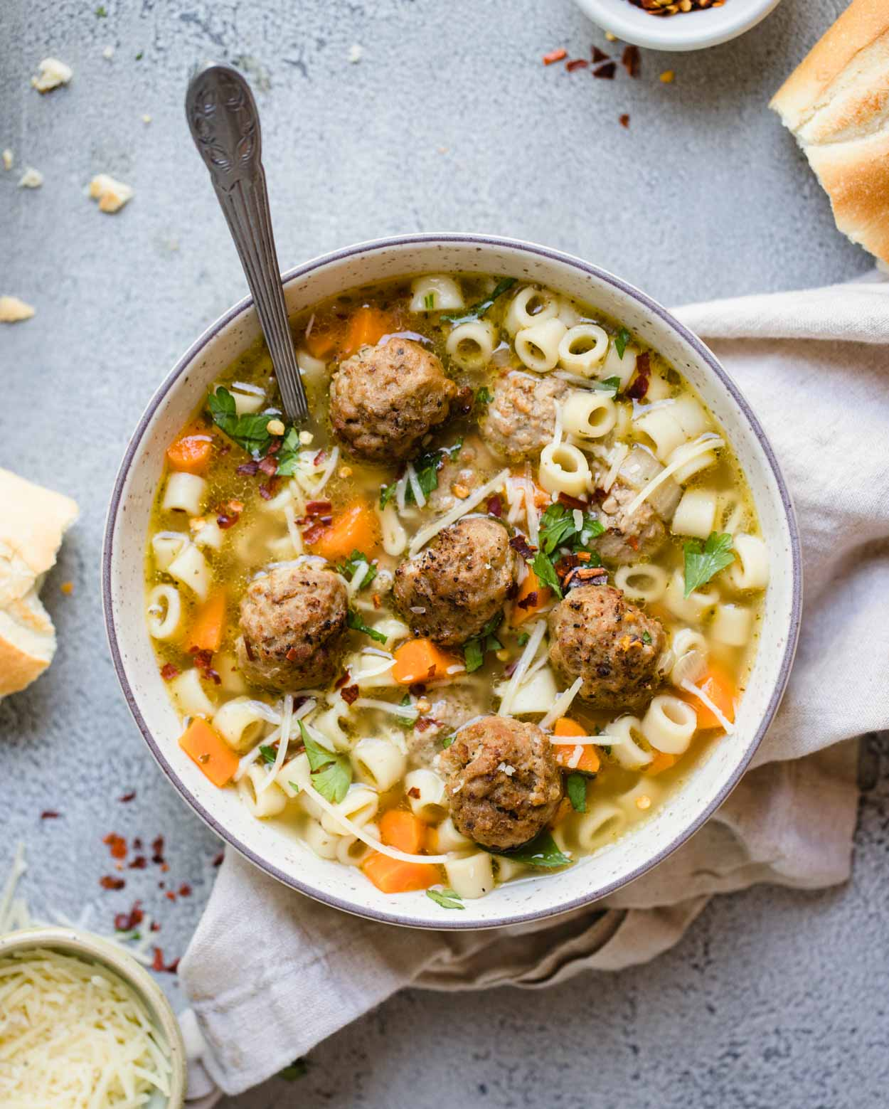 beige round bowl filled with pasta soup and meatballs
