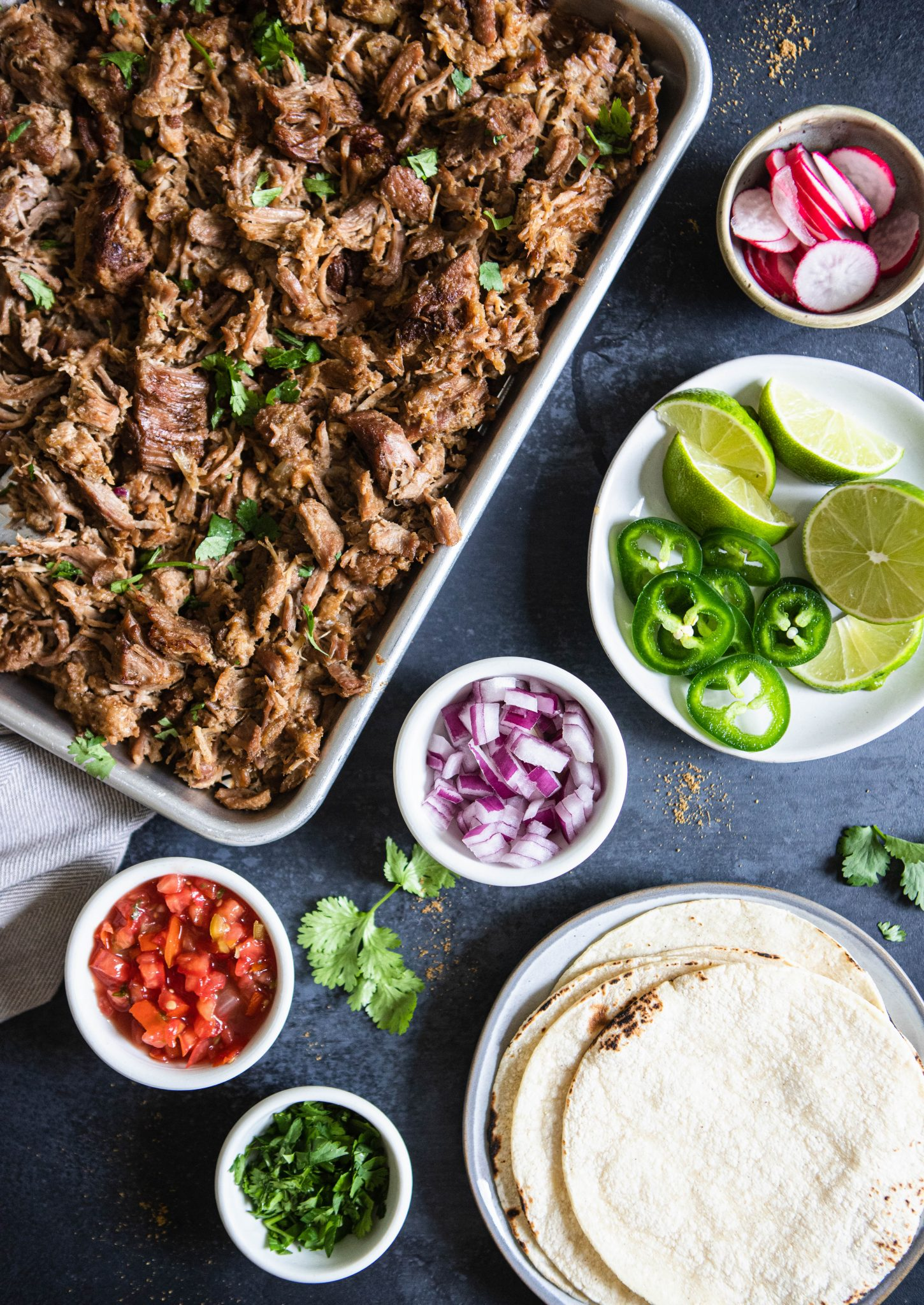 toppings for tacos and tortilla and pork carnitas
