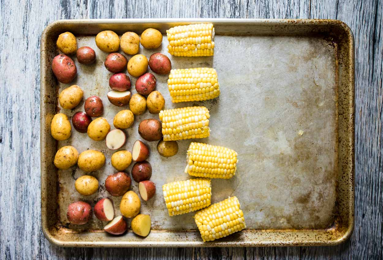 corn and potatoes on sheet pan