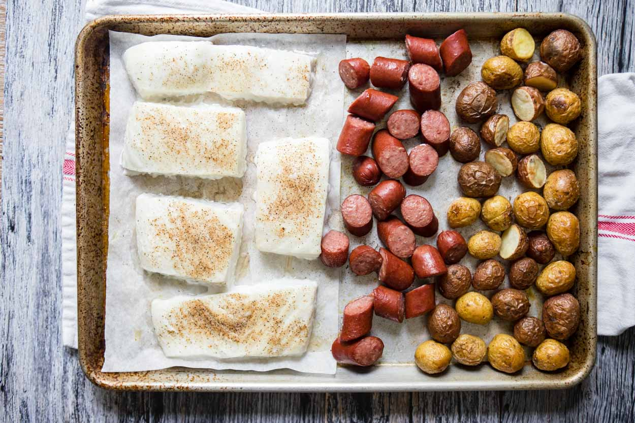 halibut, potatoes and sausage on sheet pan
