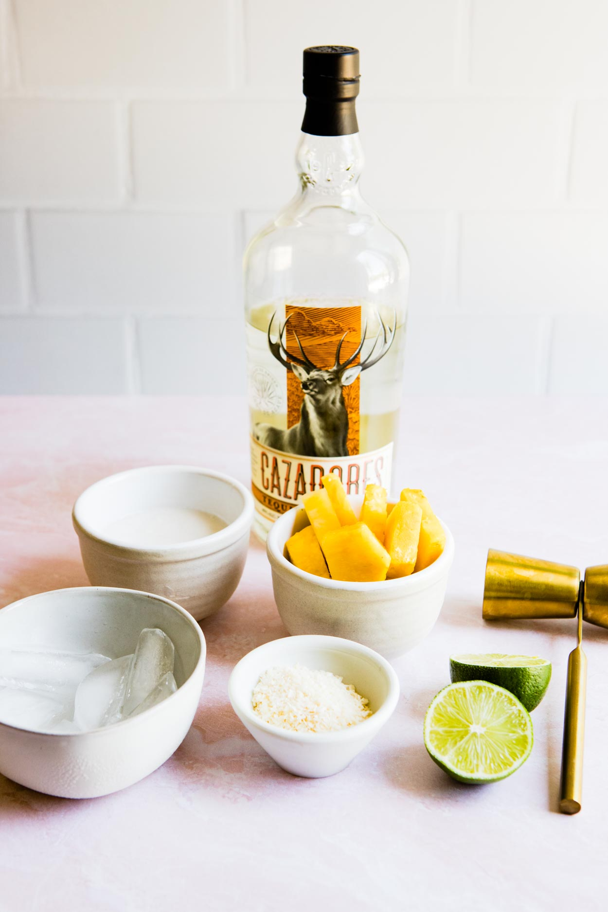 Cazadores tequila and ingredients to make pineapple margarita