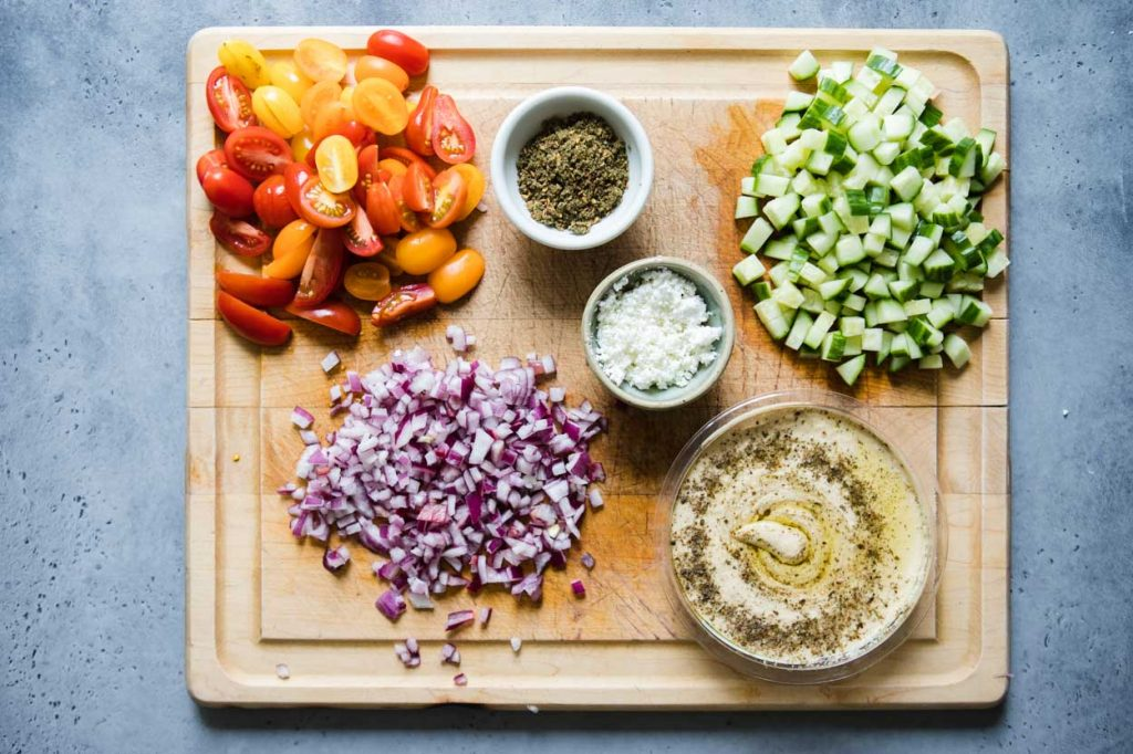 hummus ingredients prepped on a cutting board