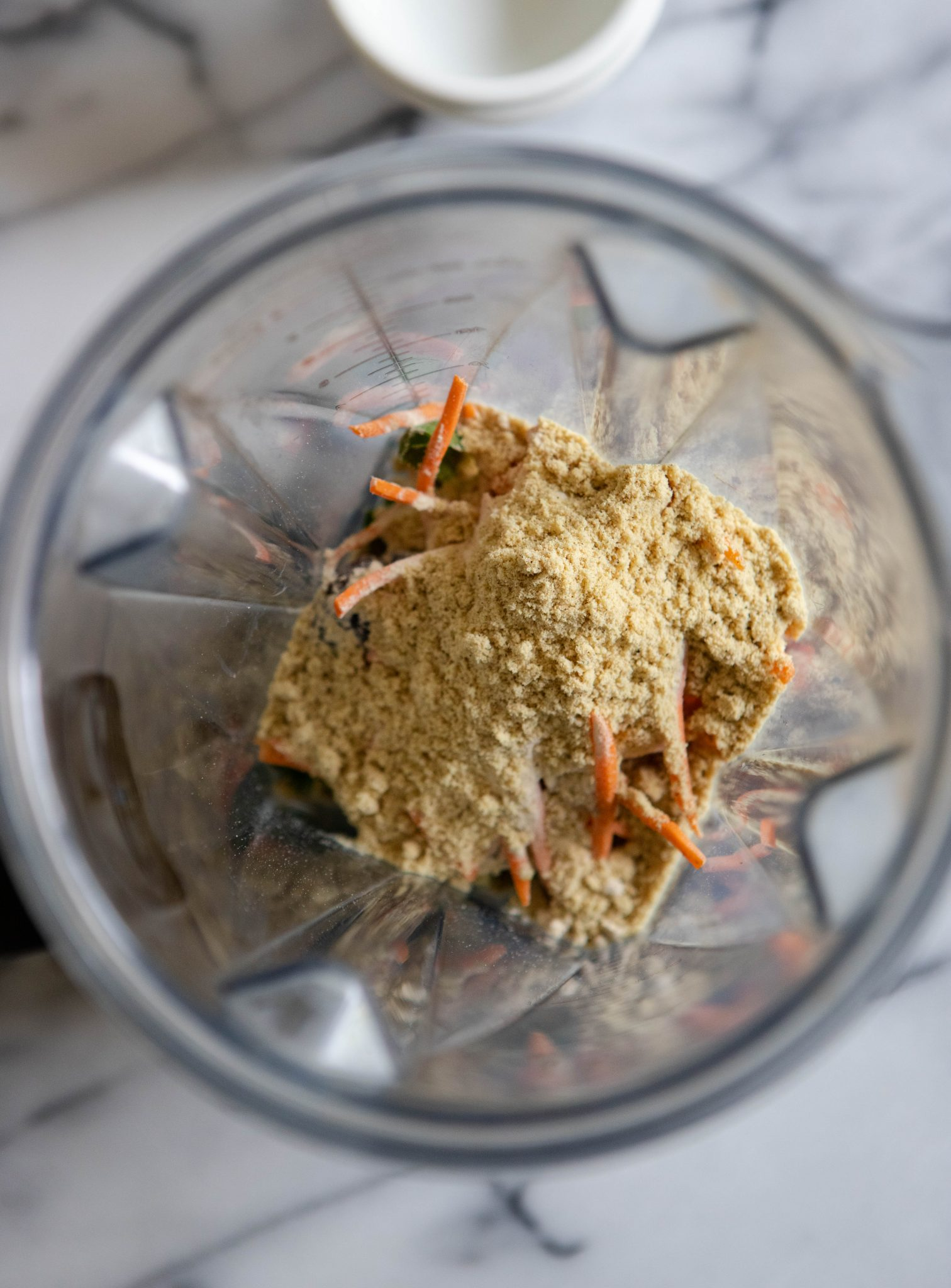 Protein powder and veggies in a blender