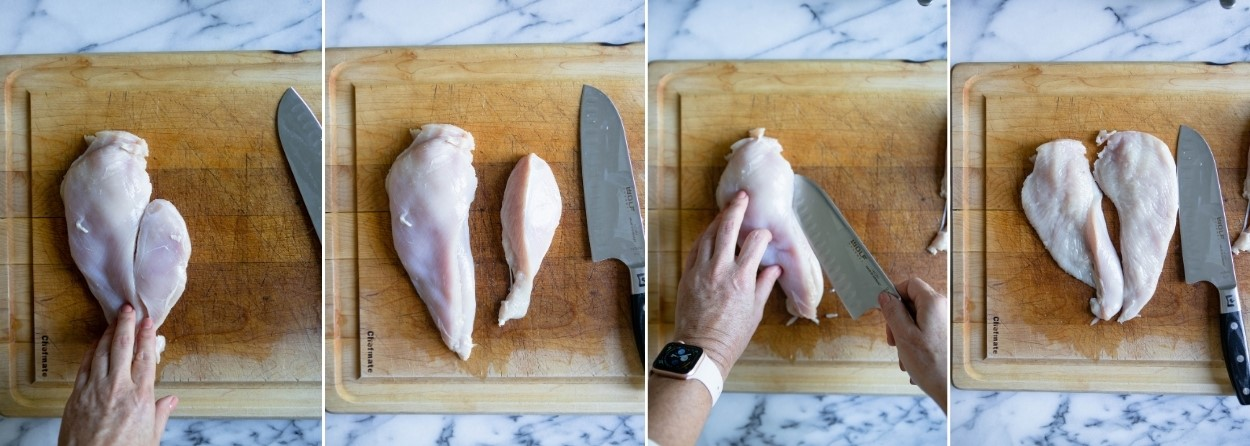 chicken breasts on a wooden cutting board being cut to make chicken cutlets