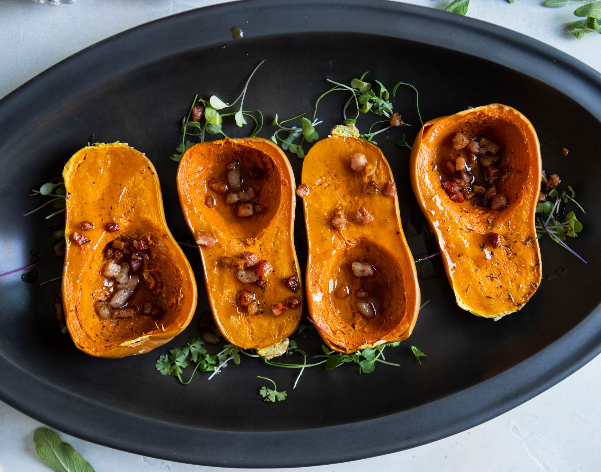 4 small butternut squashes with maple butter and pancetta sprinkled on top
