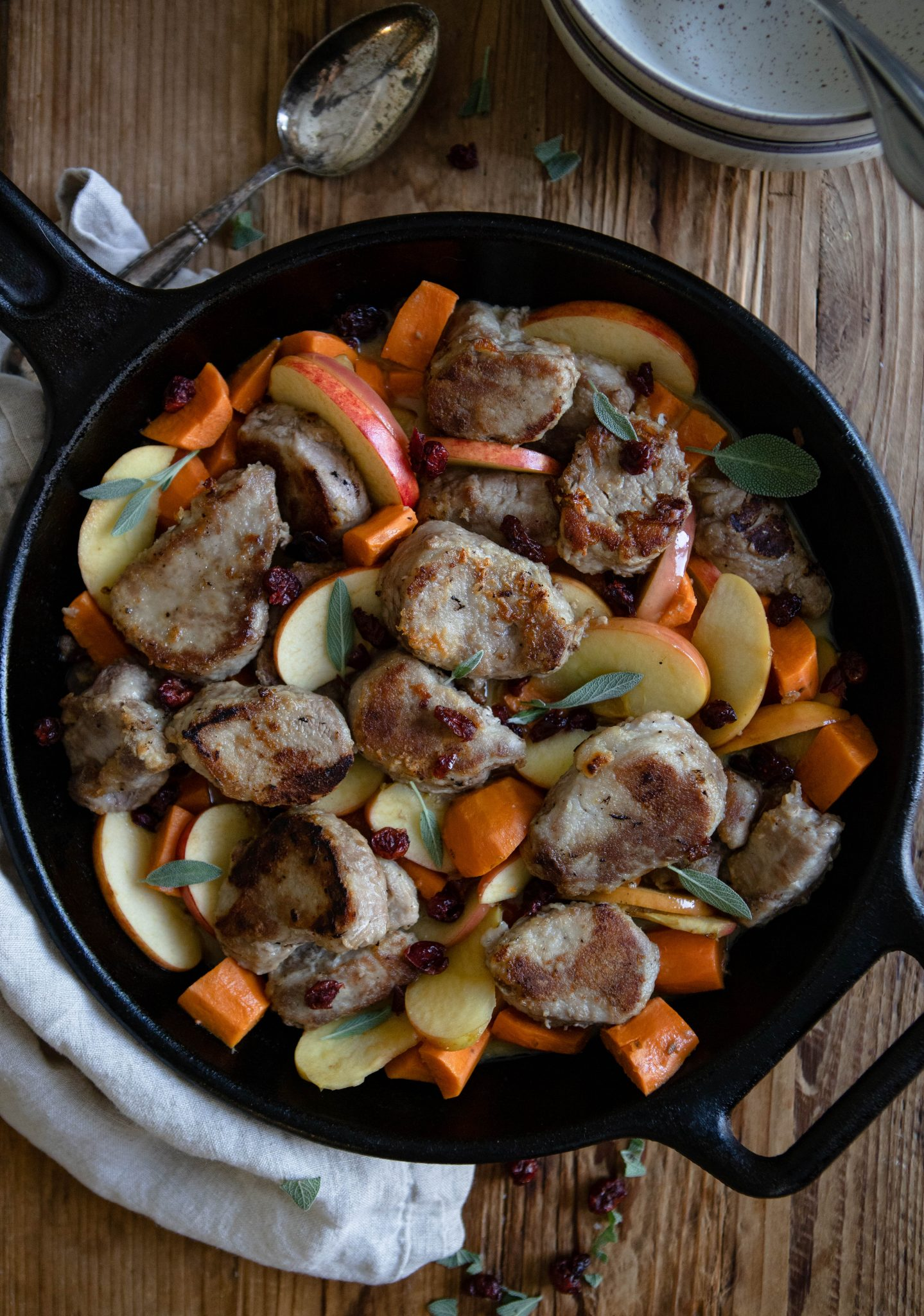 close up of pork tenderloin dish with apples and sweet potatoes