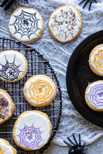 Halloween cookie ideas on a white cloth against a gray background