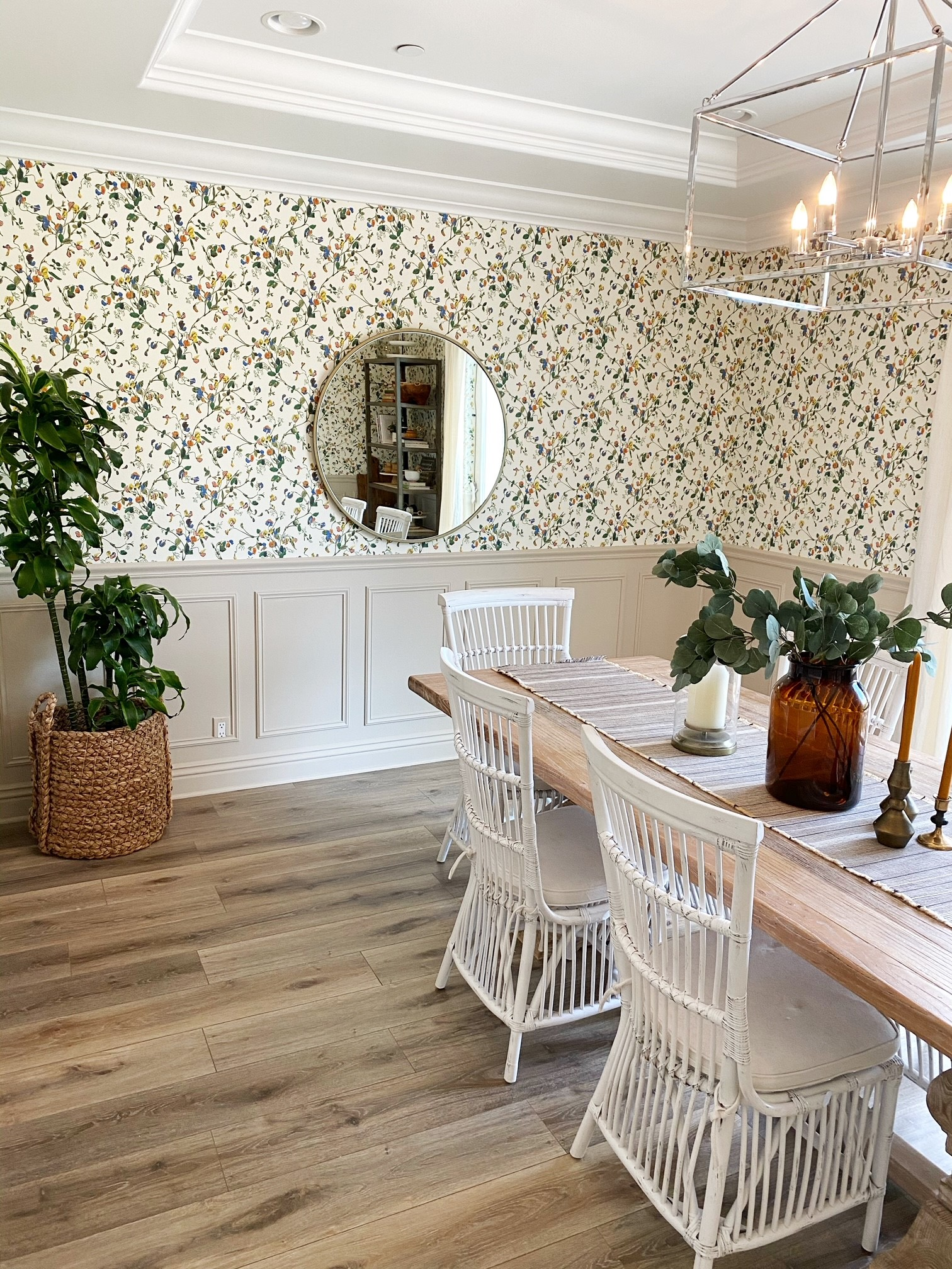 dining room with floral wallpaper and picture frame molding
