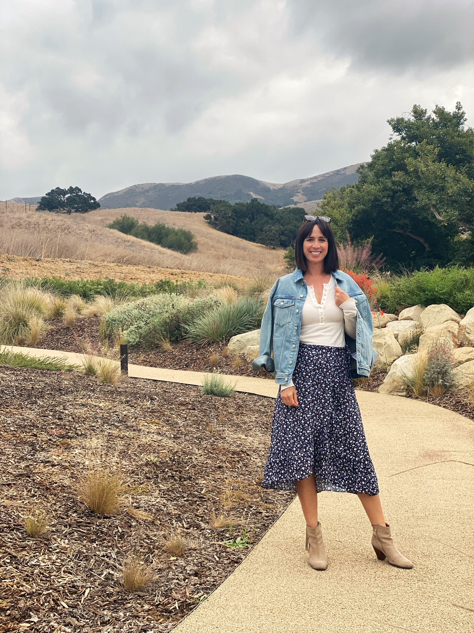 woman wearing an oversized jean jacket