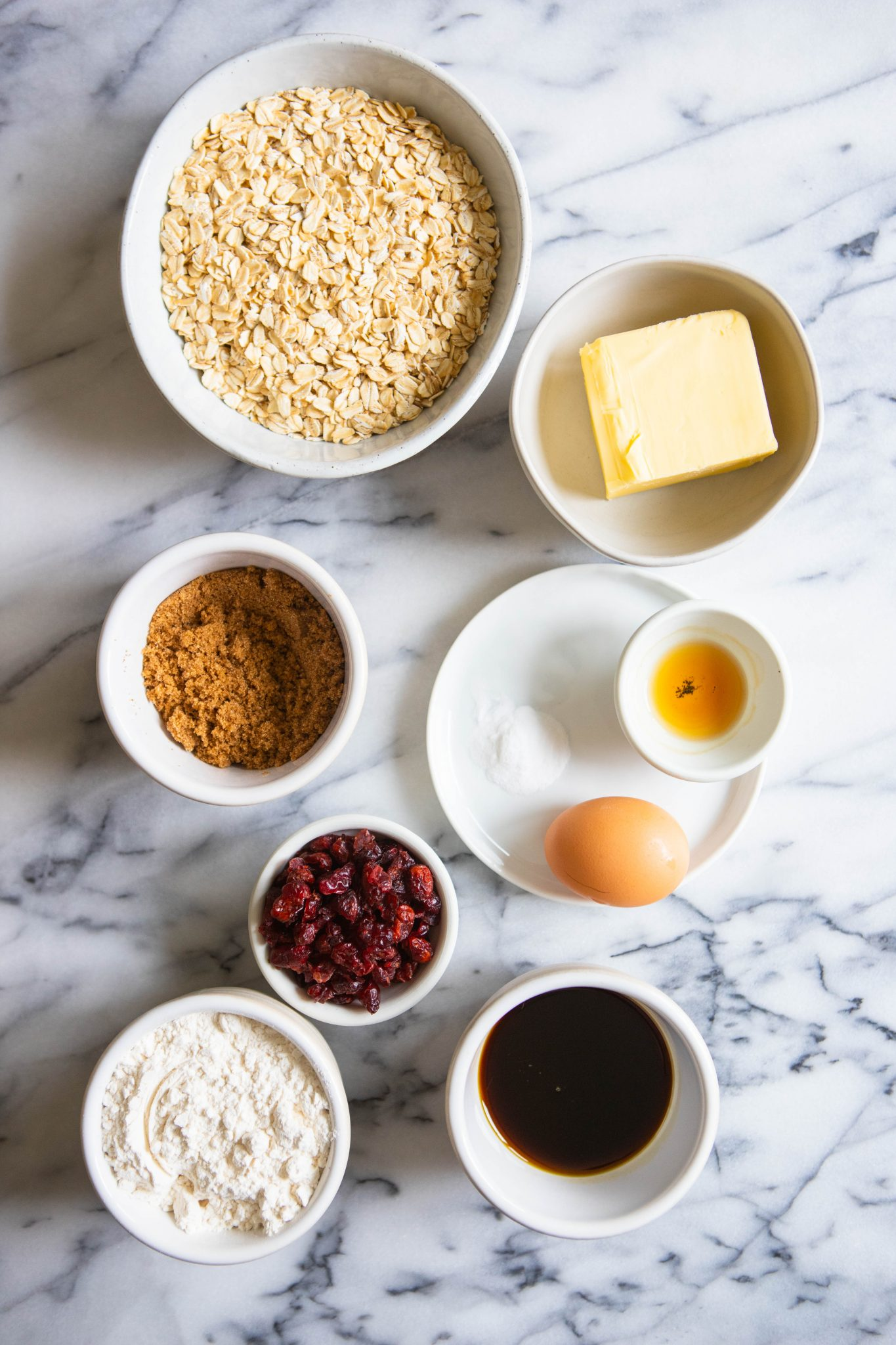 ingredients prepped in small bowls for oatmeal cranberry cookie recipe