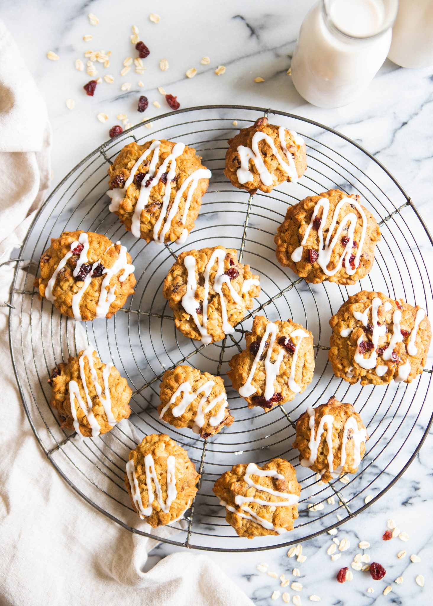 oatmeal cranberry cookies on a round vintage French cooling rack