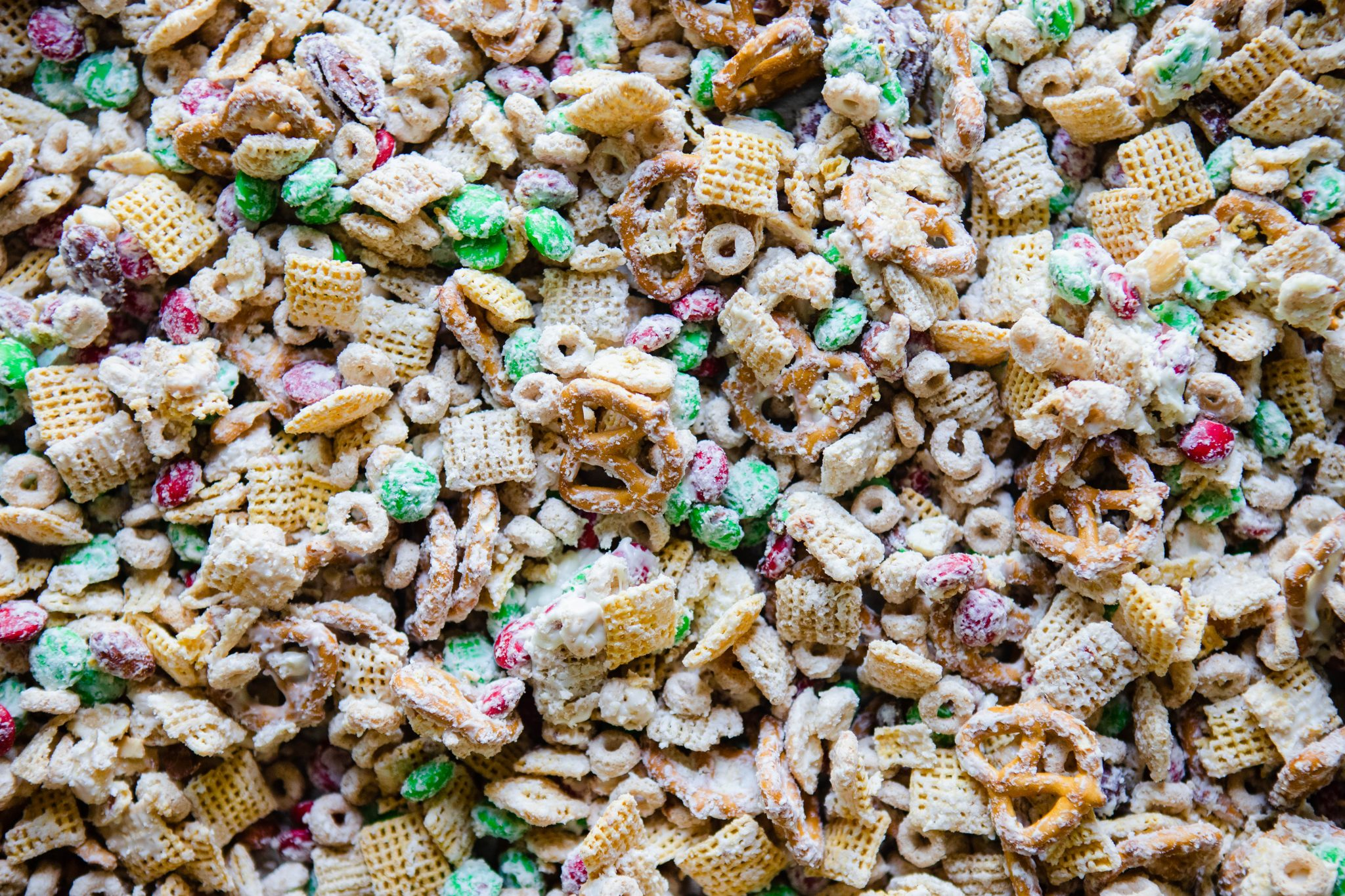 close up of white chocolate holiday Chex mix on a baking sheet