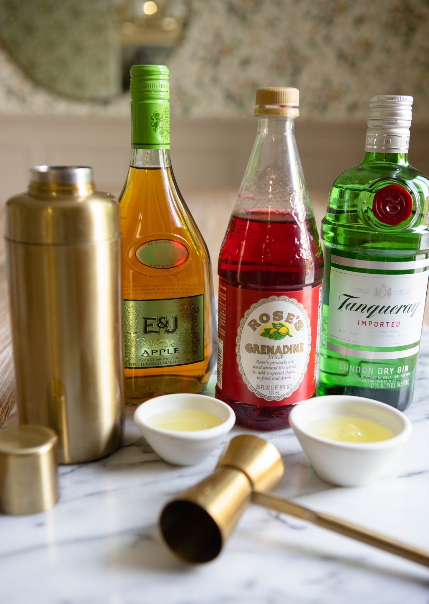 Ingredients to make a pink lady cocktail