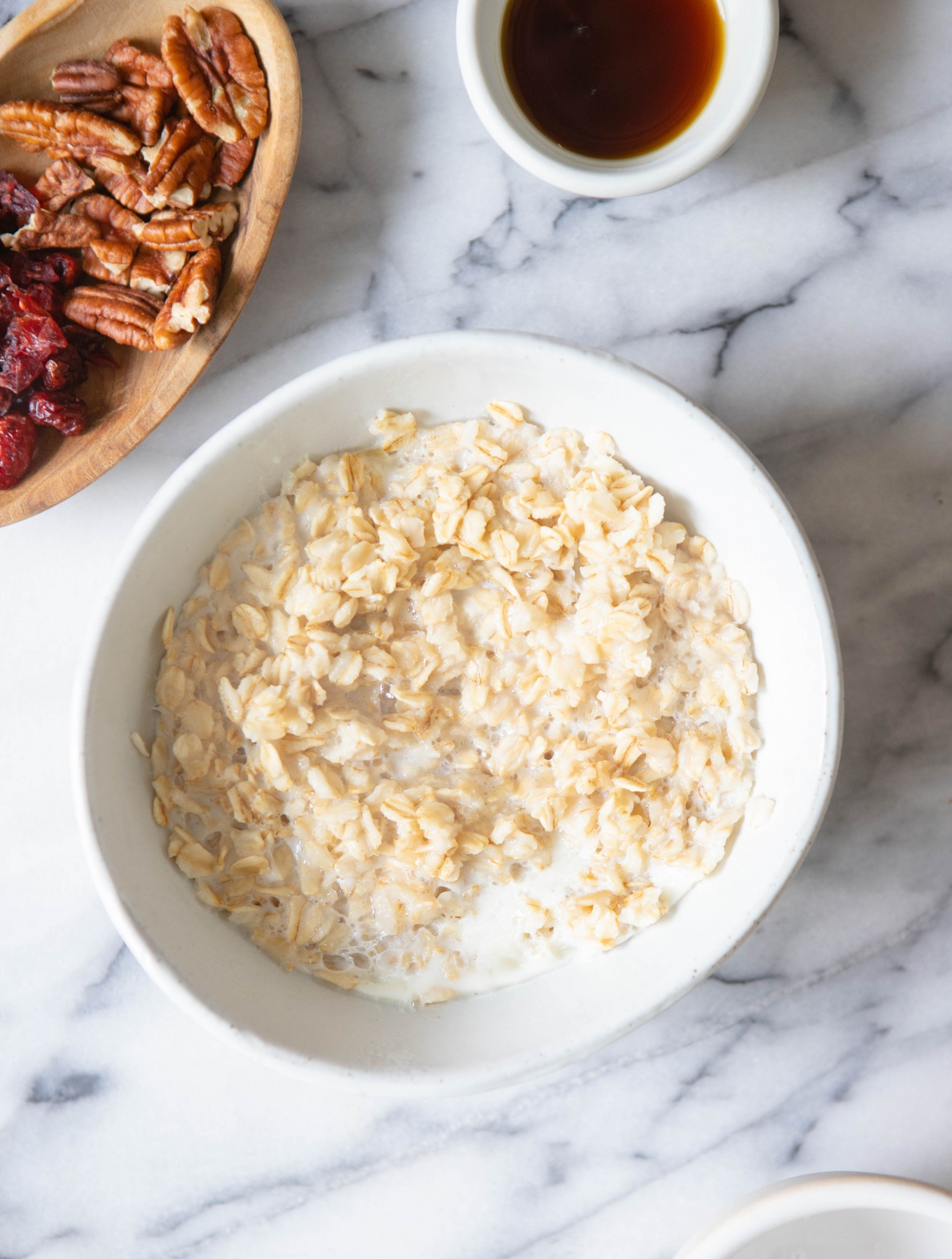 cooked oatmeal in a white bowl