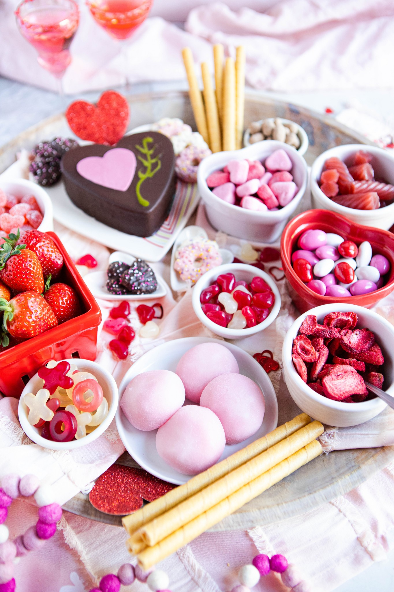 red and pink desserts arranged artfully on a platter for Valentine's Day