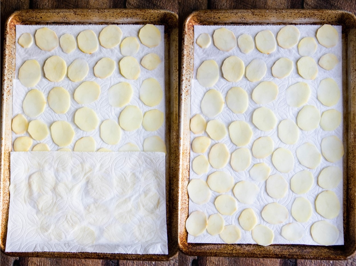 sliced potatoes laid out on a paper towel lined baking sheet