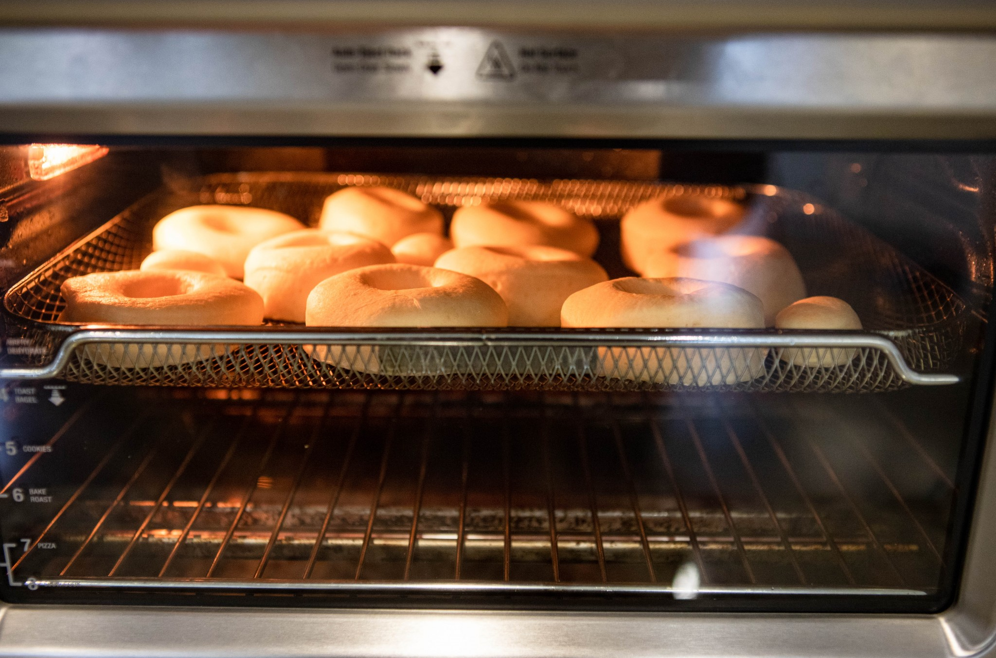 donuts in air fryer being cooked